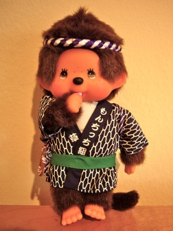 A Monchhichi monkey, whose adorable features and countless outfits make it a favorite collectible of Japanese girls.
