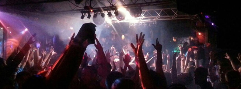 "Fans at a ""live house"" club do a ""parapara"" handjive as the artists on stage dish up their favorite songs."