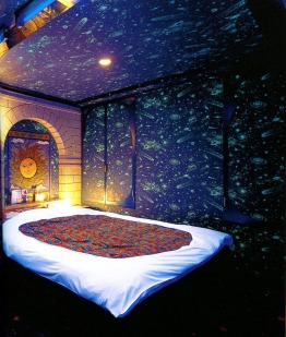 The walls of this love hotel room are covered with glow-in-the-dark shooting stars and rocket ships.