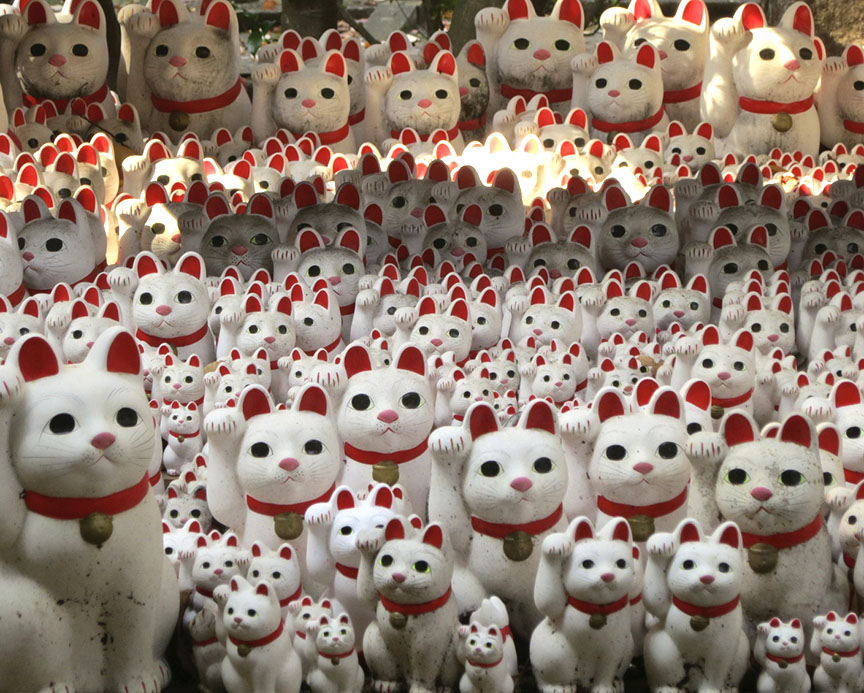 """Added bonus: There is a shrine on the temple grounds where thousands of """"good luck"""" maneki neko cat figures have been offered to ensure success in business."""