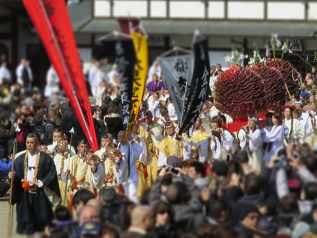 At 1:00, the participants form a procession that visits the small nearby shrine with much blowing of conch shells, before filing into the sacred bonfire area. Before torching of the mountain of cedar boughs, various ceremonies must be observed: the striking of the flint, the firing of arrows in all four directions, martial arts-like katas with a long-handled axe and a sword, the reading of rather lengthy sutras, and, of course, the recitation of the names of worthy donors (a lot of them).