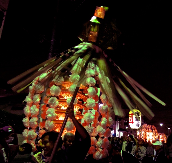 Strong men twirling pikes announcing the names of their temples danced through the streets ahead of their lanterns.