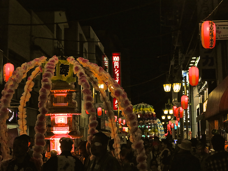 Even the streets were lined with pink lanterns as far as the eye could see.