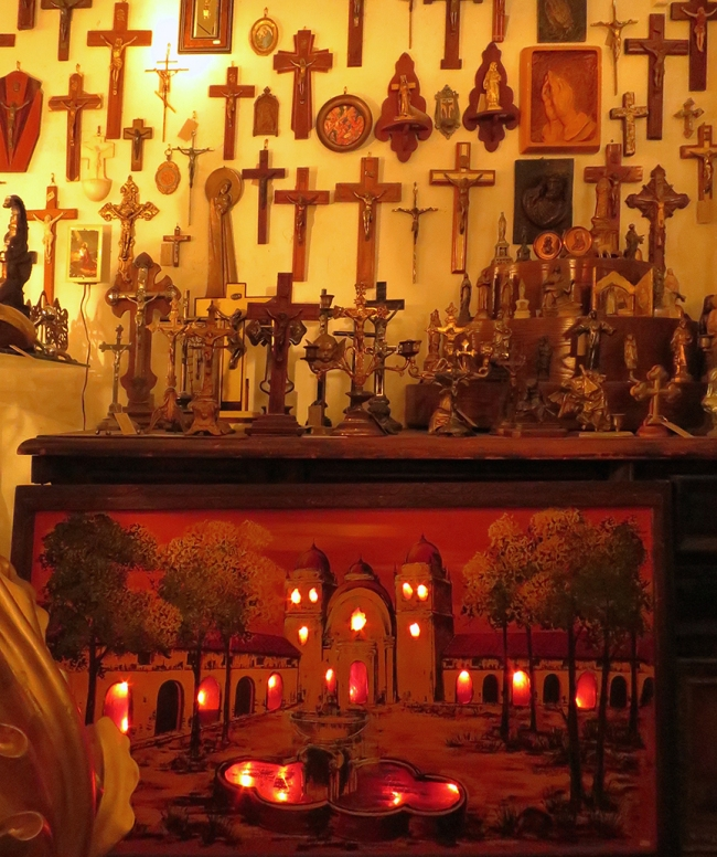 A fine selection of crucifixes for every decorating need, plus this one-of-a-kind light-up mission painting.