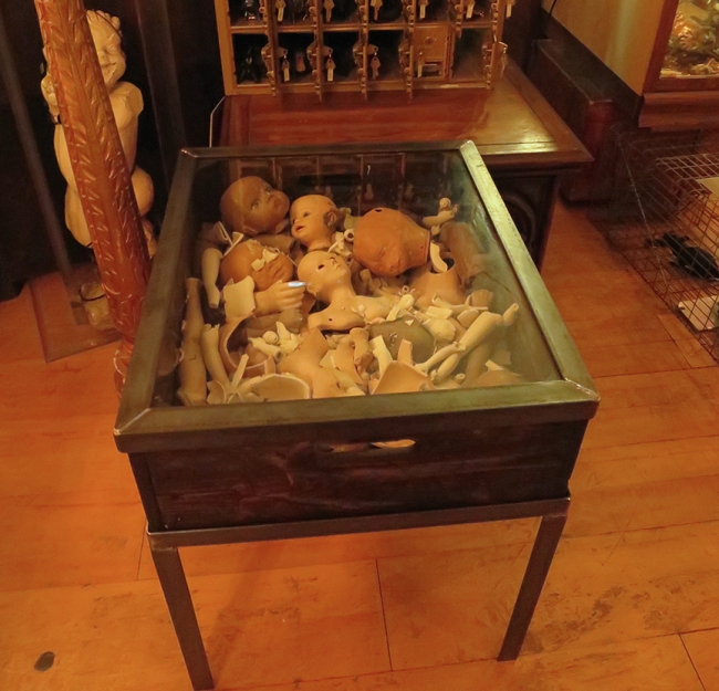This lovely end table will certainly be a conversation piece. If your favorite topic is dismembered dolls, that is.