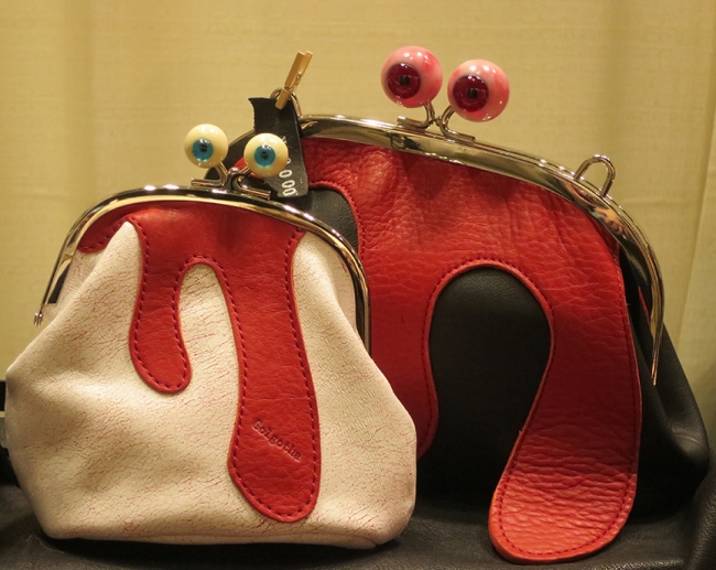 Eyeball clasp purses, leaking a little O Positive.