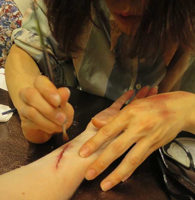 """After that, """"bruising and inflammation"""" were pounced on with a soft brush around the gash."""