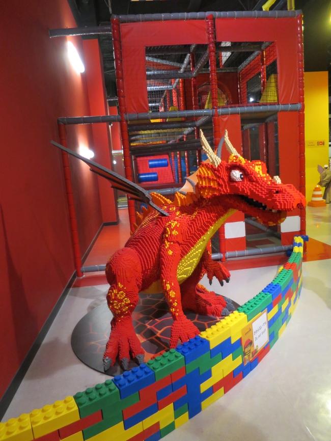 Charizilla gives his big green cousin a helping hand at Tokyo Legoland.