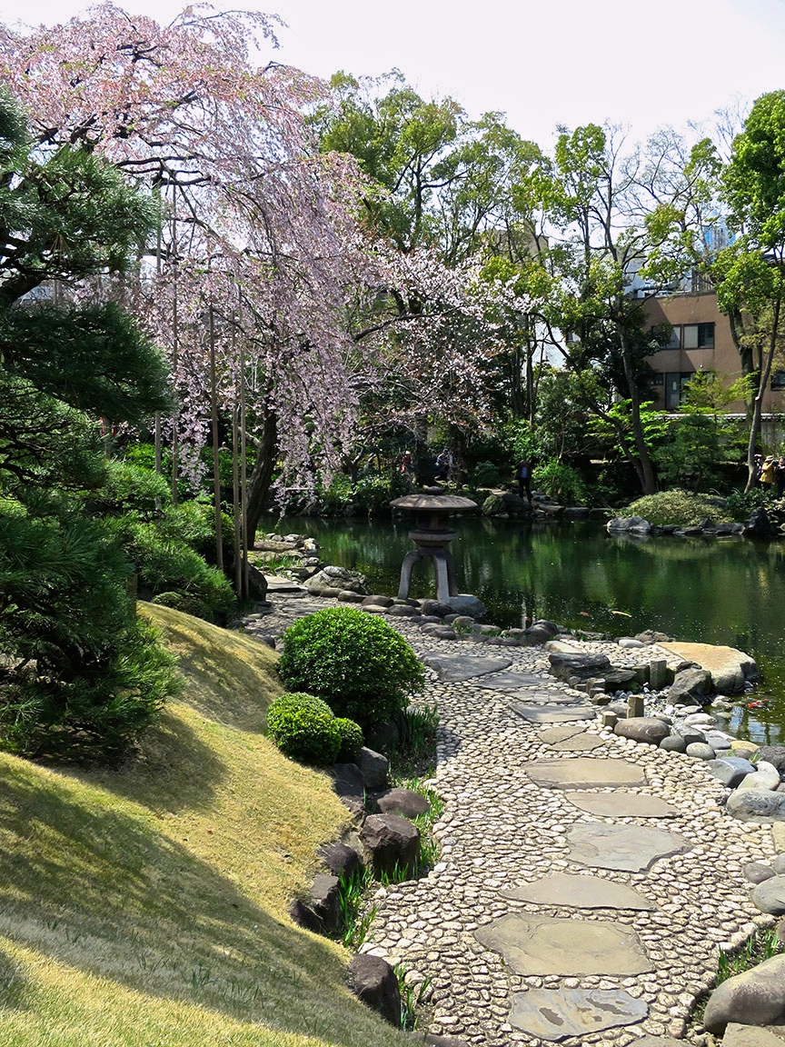 You enter the garden by buying a ticket to the museum of giant prayer plaques (also interesting and seldom open). When you emerge out the back, a path leads to this beautiful pond.