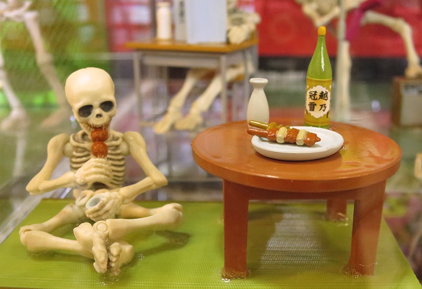Just because he's lacking a little skin to go with his bones doesn't mean Uncle Skel doesn't enjoy a few skewers of yakitori washed down with your best sake.