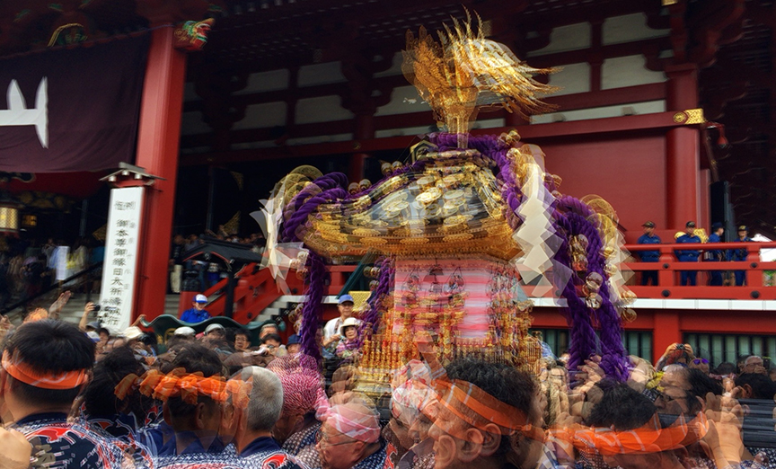 It's hard to capture the sheer energy of a Japanese festival in a single snapshot, because the shrines aren't just carried through the streets, they're danced.