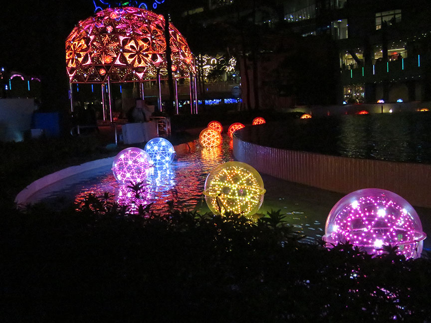 These color-changing light spheres are bobbing around in all the fountains this year