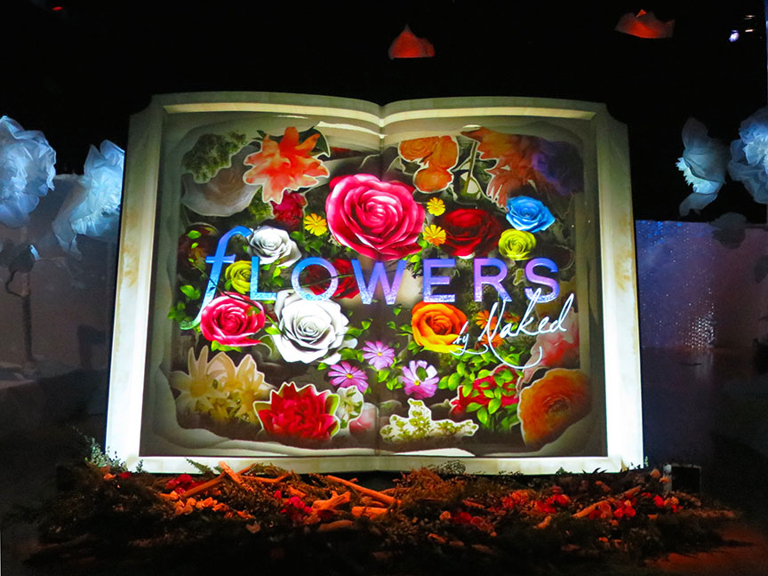 This giant book comes alive, with petals that fly off the page and swirl around the room.