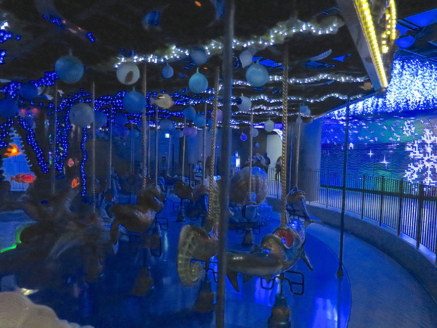 The carousel has been tarted up with blue and white lights.
