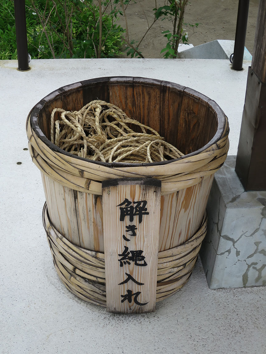 After Jizo-san swoops in to save you in the nick of time, you come back and set him free by thanking him, untieing a rope and tossing it in the bin.