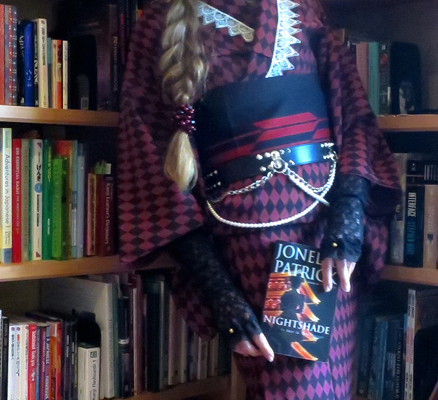 Me holding the first copy of Nightshade in my hot little hands, and yes, that's a Princess Style kimono I'm wearing because that's how we spell SLACKING OFF FROM WORK around here
