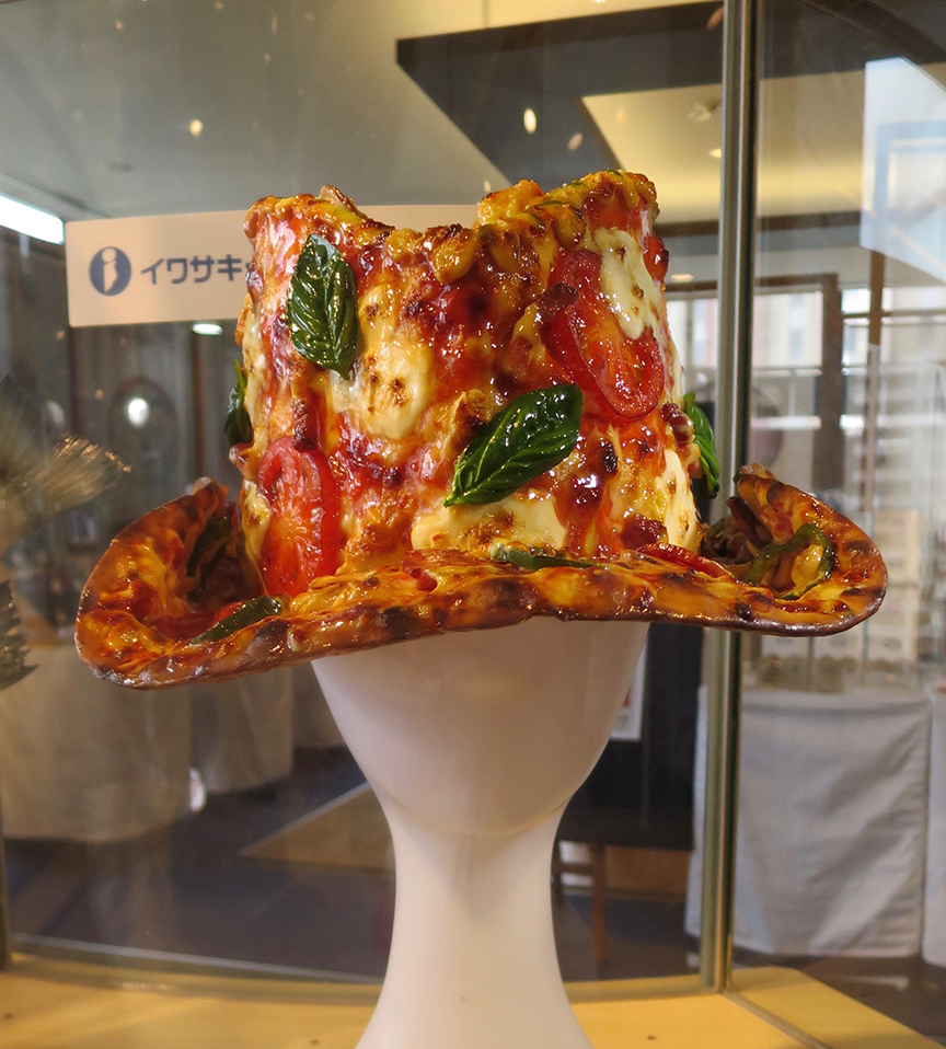 ...and a pizza hat. Wait, a PIZZA HAT? (It was XX who dreamed up this one.)