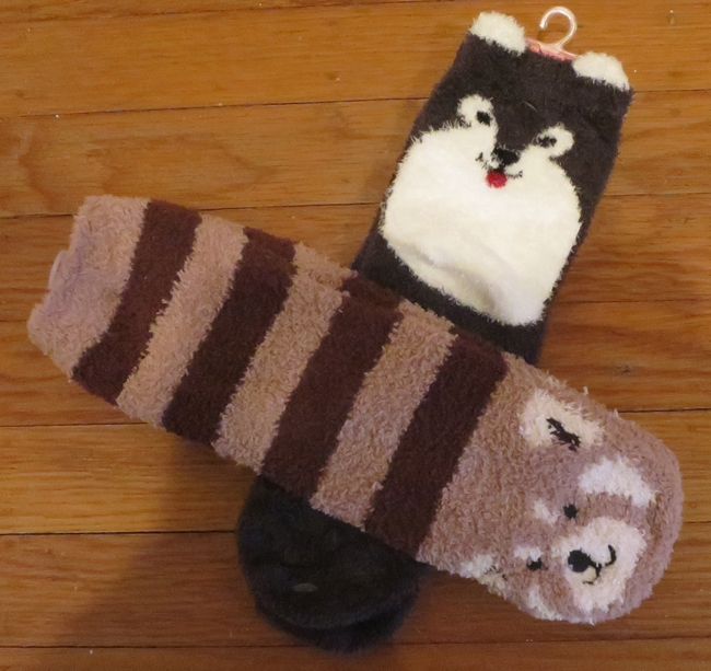 So, the thing you can't really tell from seeing them on the little hanger thingies is that the face of the brown one is on your toes, but the face of the gray one is above your heel, which makes for extra-cuteness above your shoes as you walk away