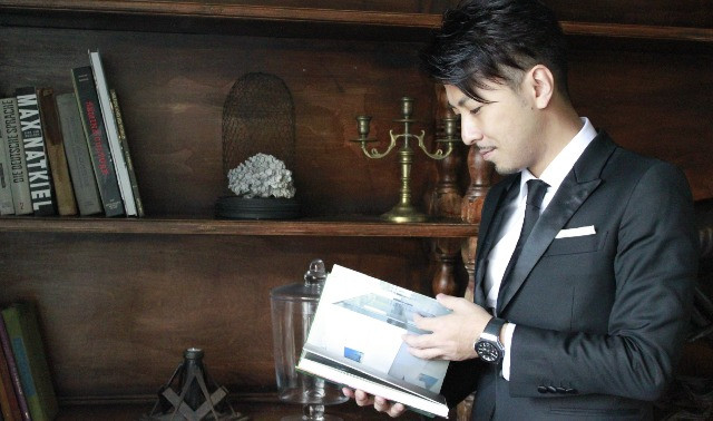 Japanese host paging through book