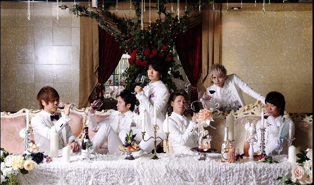 Japanese hosts dressed in white at host club