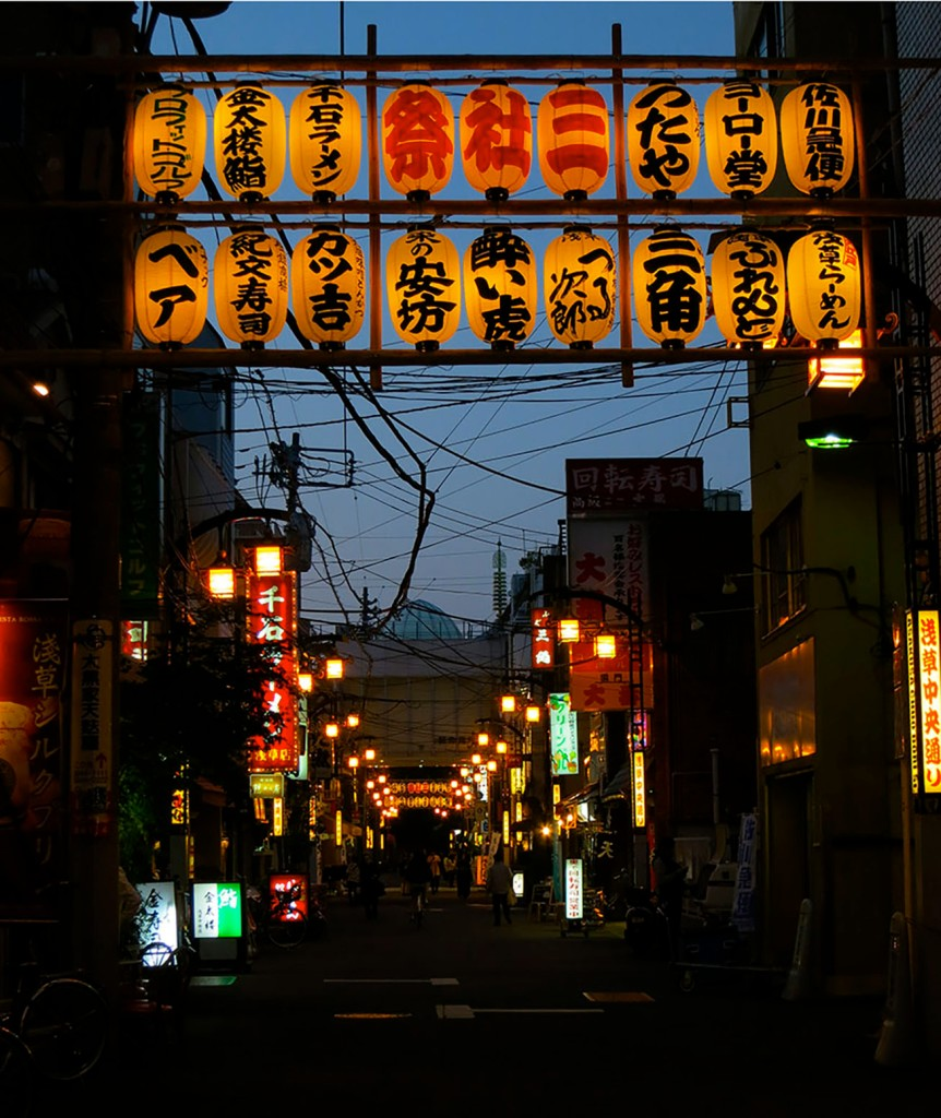 Old fashioned street in Asakusa lit up at night