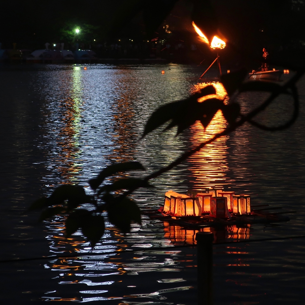 Lanterns and bonfire at toro nagashi event, Shinobazu Pond, Asakusa