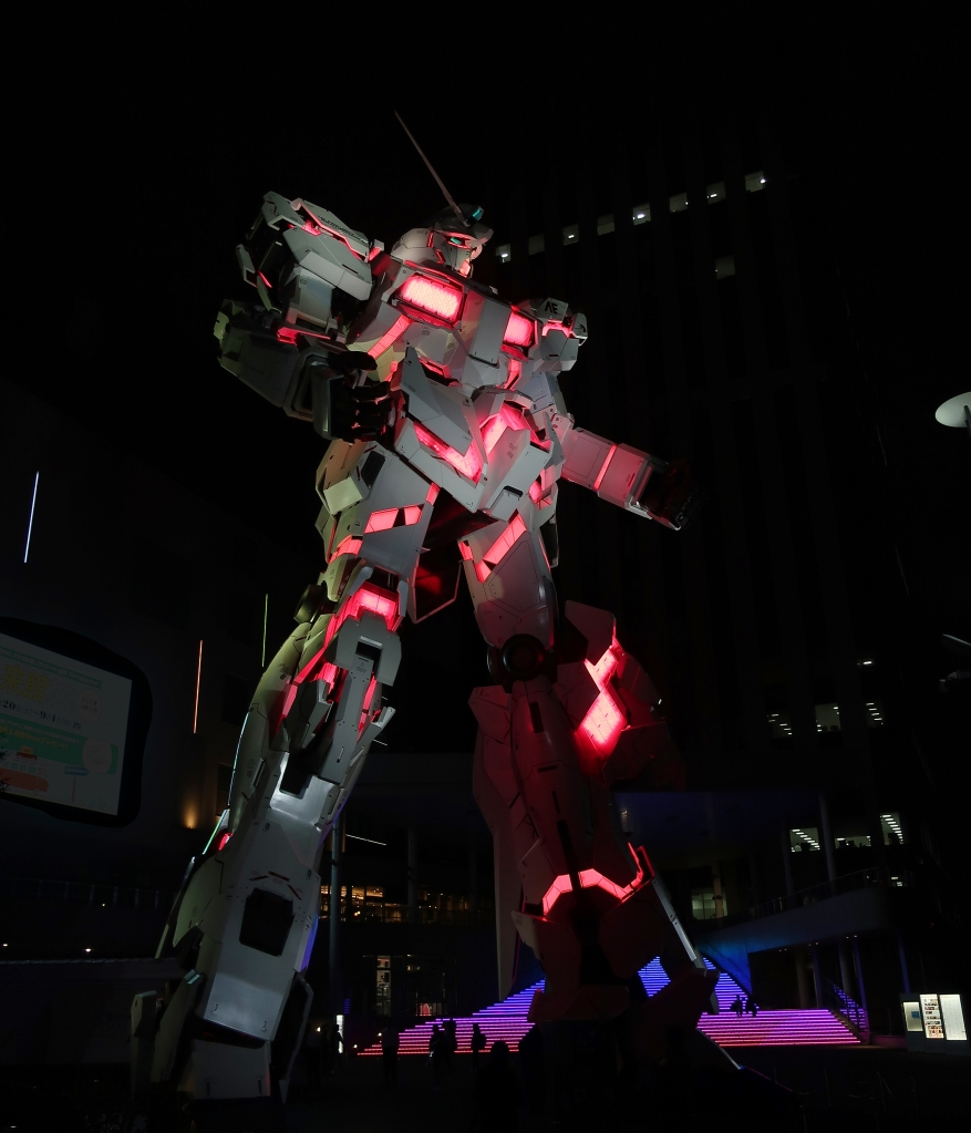 Giant Gundam Unicorn lit up at night