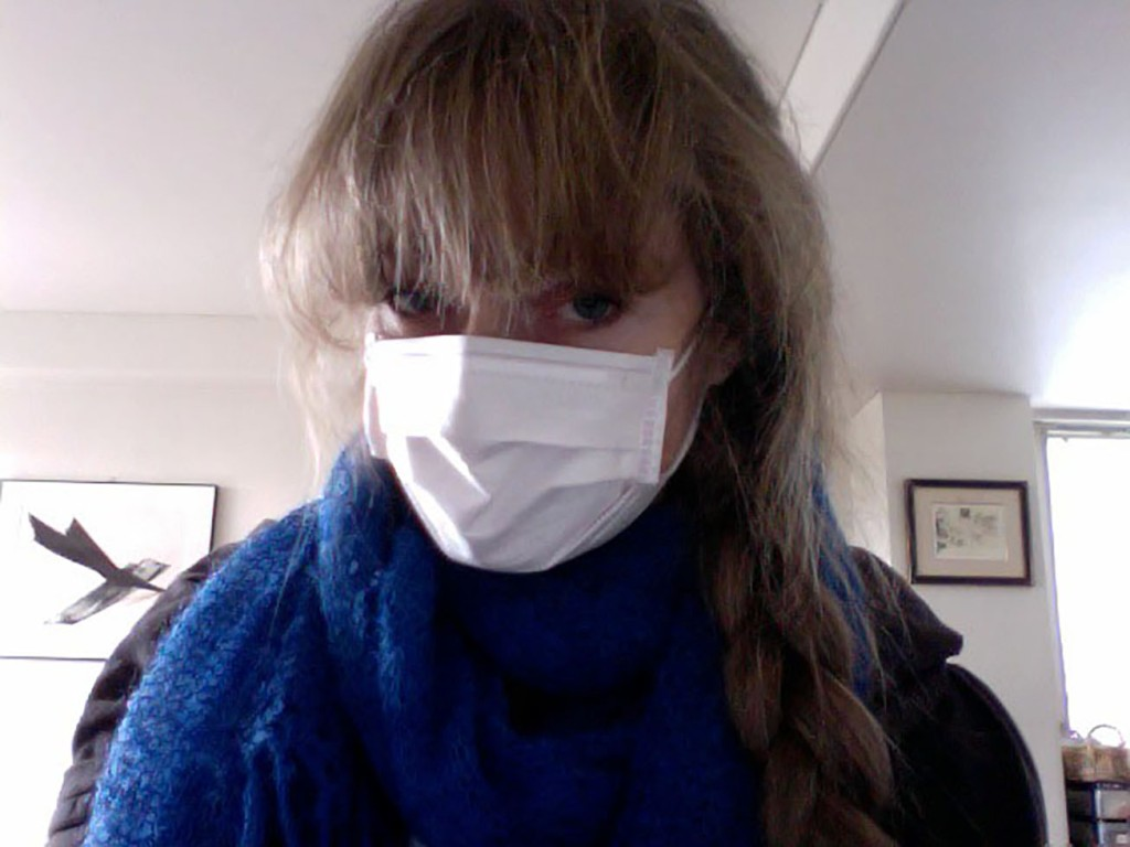 Author Jonelle Patrick wearing face mask