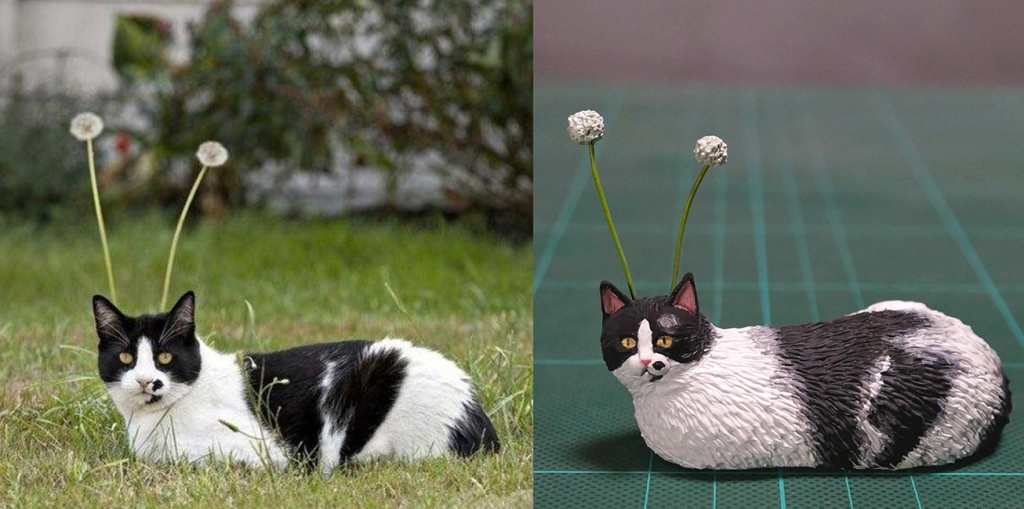 @Meetissai sculpture of cat with dandelion stalks coming out of head