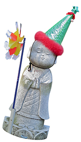 Stone Jizo figure wearing party hat