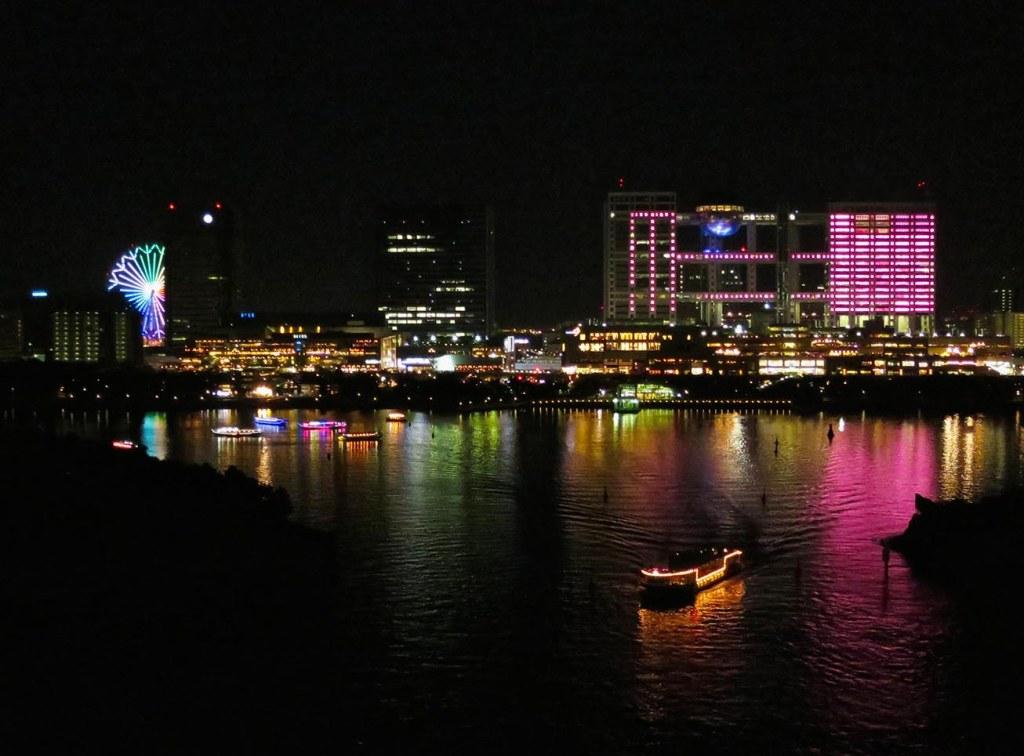 Odaiba skyline lit up at night with pleasure boats
