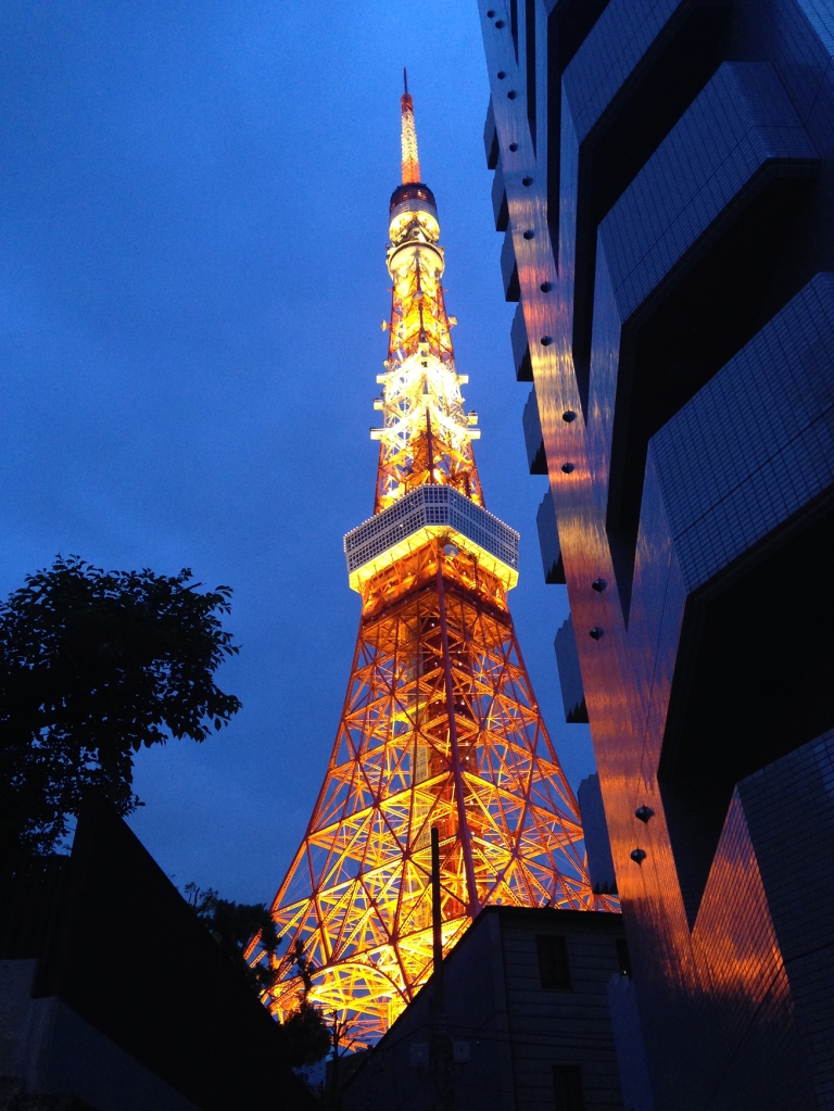 Tokyo Tower lit up at twilight