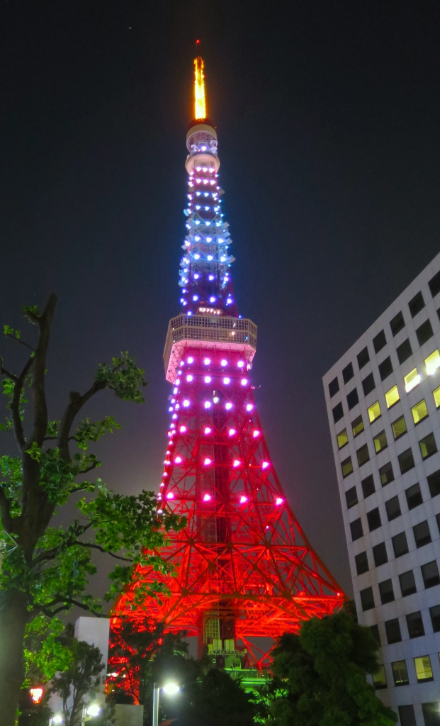 Tokyo Tower lit up in pink and blue at night
