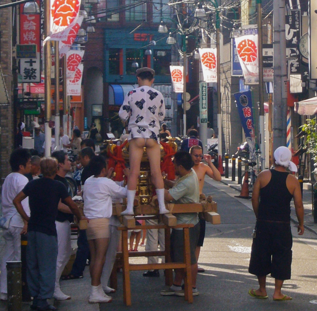 Omikoshi team getting ready for parade, wearing fundoshi