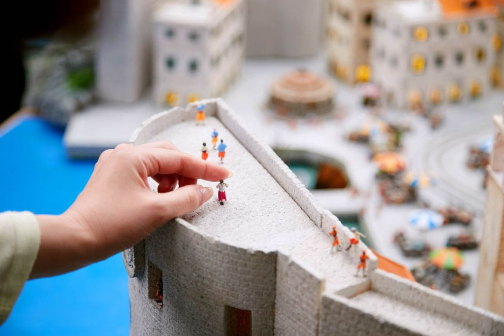 Small Worlds Tokyo model with custom 3D scanned figures