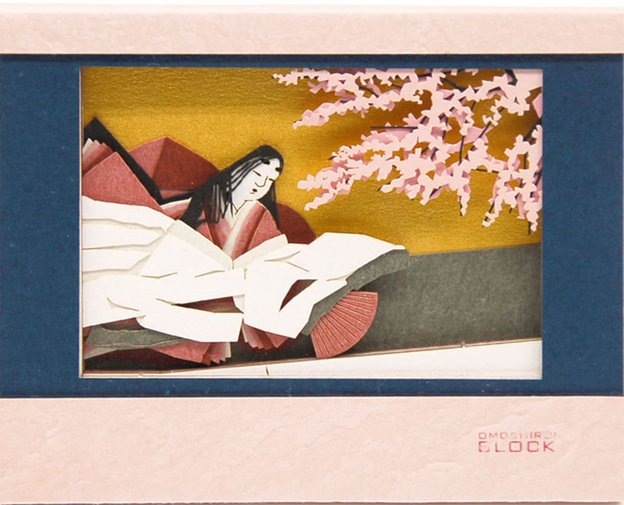 Notepad from Omoshiroi online store that reveals Heian woman in kimono as it's used