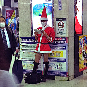 Man dressed in sexy Santa miniskirt at Shibuya station