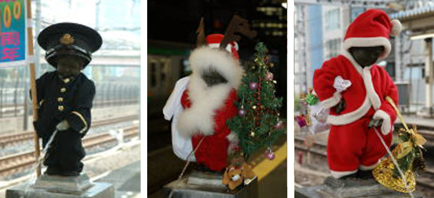 The nude peeing boy statue at JR Hamamatsucho station dressed as Santa in the years 2009, 2010, 2011