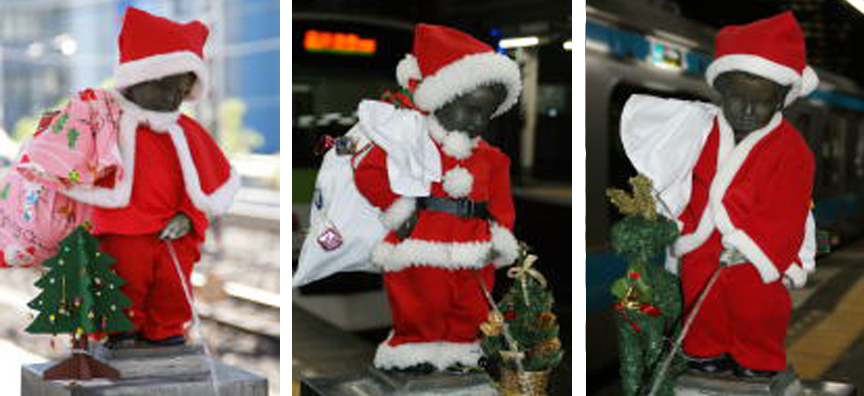 The nude peeing boy statue at JR Hamamatsucho station dressed as Santa in the years 2012, 1013, 2014