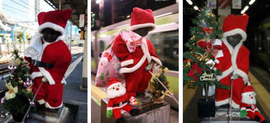 The nude peeing boy statue at JR Hamamatsucho station dressed as Santa in the years 2015, 2016, 2017