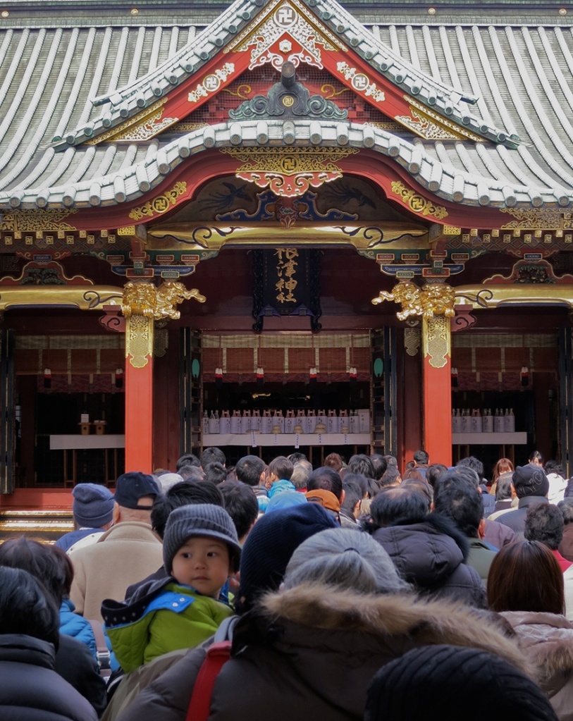 People waiting for hatsumode first shrine visit of the new year at the Nezu Shrine in Tokyo