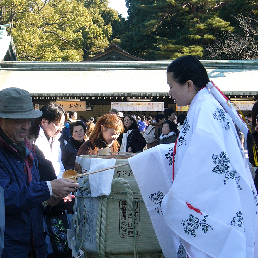 Shrine maiden serving new year's sake at the Meiji Shrine